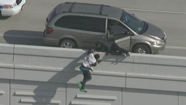 WorldStarhiphop:2 Suspects Jump Down 20 Feet Off Freeway Wall To Try And Escape From Police In Houston
