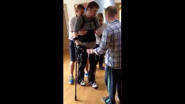 Man First time walking for 11 years in EKSO suit
